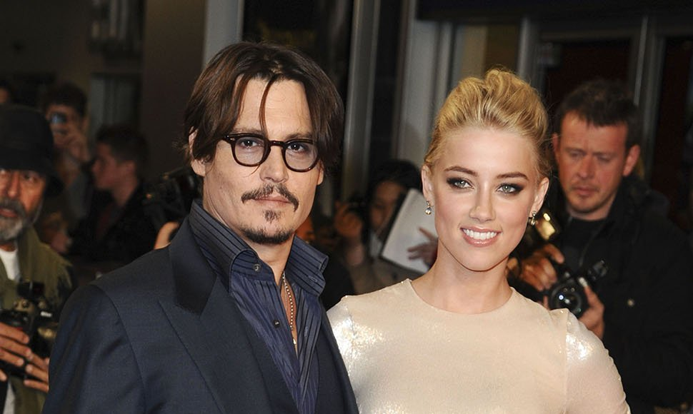 Johnny Depp y su esposa  Amber Heard.