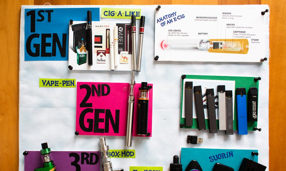 Susanne E. Tanski of Dartmouth College tries to familiarize parents with a variety of vaping products.  (Elizabeth Frantz for The New York Times)