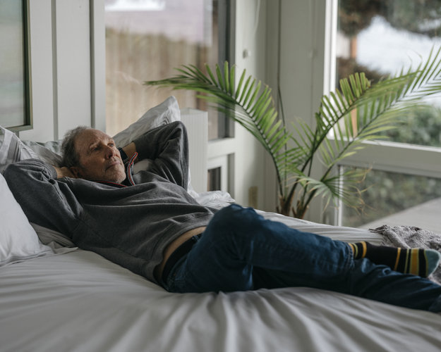 Charles Hall, 75, on an Afloat Water Bed in his home in Washington State. (Ian C. Bates for The New York Times)